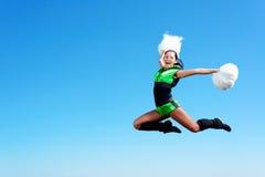 Cheerleader girl jumping Royalty Free Stock Photos