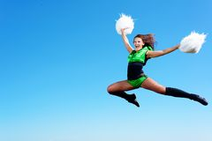 Cheerleader girl jumping Stock Photos