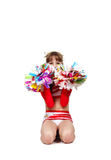 Cheerleader girl sitting with pompons Stock Image