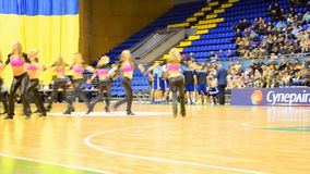 Cheerleader group dancing, F4 Final Basketball championship, Kiev, Ukraine. KIEV - MAR 07: Cheerleader group dancing during F4 Final Basketball championship in stock video footage
