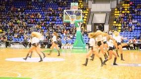 Cheerleader group dancing, F4 Final Basketball championship, Kiev, Ukraine. KIEV - MAR 07: Cheerleader group dancing during F4 Final Basketball championship in stock video