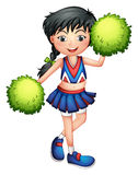 A cheerleader with her green pompoms Stock Images
