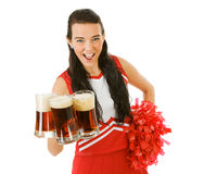 Cheerleader: Holding a Handful of Beer Mugs. Cute female as an American sports cheerleader, in red and white outfit.  Isolated on white background Stock Photography