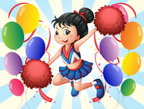 A cheerleader holding red pompoms with balloons Stock Images