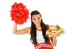 Cheerleader: Holding Sandwiches And Cheering. Cute female as an American sports cheerleader, in red and white outfit.  Isolated on white background Stock Images