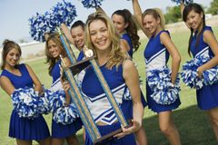 Cheerleader Holding Trophy Royalty Free Stock Images