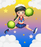 A cheerleader jumping with her green pompoms. Illustration of a cheerleader jumping with her green pompoms Royalty Free Stock Image
