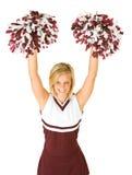 Cheerleader: Leuke Vrouw die met Poms in de Lucht toejuicht stock foto's