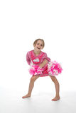 Cheerleader little girl in pink. Outfit and pom poms Stock Photos