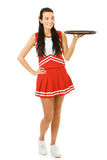 Cheerleader: Looking at Empty Restaurant Tray. Cute female as an American sports cheerleader, in red and white outfit.  Isolated on white background Royalty Free Stock Photo