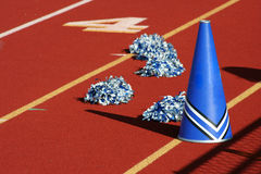 Cheerleader megaphone. Cheerleader pom poms and megaphone at a football game Stock Photo