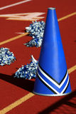 Cheerleader megaphone. Cheerleader pom poms and megaphone at a football game Stock Images