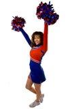 Cheerleader met pom poms Stock Afbeelding