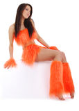 Cheerleader in orange costume Stock Photos