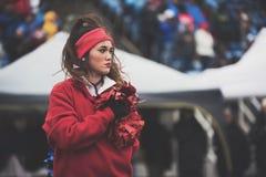 Cheerleader in red sweatshirt Royalty Free Stock Photos
