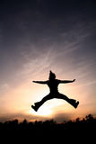 Cheerleader in the Sky. Jumping Girl in the Sunset royalty free stock photo