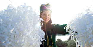 Cheerleader smiling, sun behind Royalty Free Stock Photo