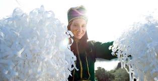 Cheerleader smiling, sun behind Royalty Free Stock Photo