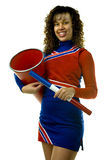Cheerleader with Spirit Stick and Megaphone. Uniformed cheerleader strikes a pose holding a spirit stick and a megaphone isolated on white Royalty Free Stock Photography