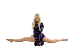 Cheerleader splits with poms down Royalty Free Stock Photos