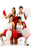 Cheerleader squad. Posing in the studio, isolated on white Royalty Free Stock Photos