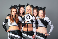 Cheerleader Team With Megaphone. Rooting for their team Stock Photos