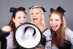 Cheerleader Team With Megaphone. Rooting for their team Royalty Free Stock Image