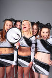 Cheerleader Team With Megaphone. Rooting for their team Stock Images
