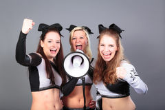 Cheerleader Team With Megaphone. Rooting for their team Stock Photo