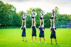 Cheerleader Team Practicing Stock Photos