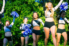 Cheerleader Team Practicing. Cheerleaders practicing on playing field on a summer day Royalty Free Stock Photography