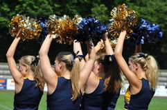 Cheerleader waving pompoms Royalty Free Stock Photography