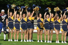 Cheerleader waving pompoms Royalty Free Stock Images