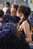Cheerleader waving pompoms Royalty Free Stock Photos