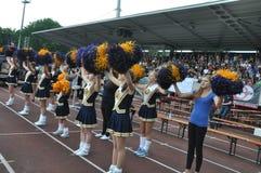 Cheerleader waving pompoms Stock Photos