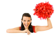 Cheerleader: White Card Look Over with Pom. Cute female as an American sports cheerleader, in red and white outfit.  Isolated on white background Royalty Free Stock Photography