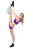 Cheerleader woman dancer in modern twine pose Stock Photos