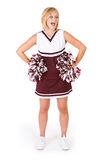 Cheerleader: Woman Glances To The Side With Poms. Pretty football or basketball cheerleader on white background Royalty Free Stock Photo
