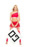 Cheerleader woman pointing her finger at a board Royalty Free Stock Photos