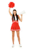 Cheerleader: Yelling Through a Megaphone. Cute female as an American sports cheerleader, in red and white outfit.  Isolated on white background Stock Photography