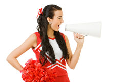 Cheerleader: Yelling Through a Megaphone. Cute female as an American sports cheerleader, in red and white outfit.  Isolated on white background Stock Photos