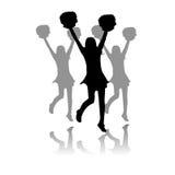 Cheerleaderleistungsschattenbild Stockfoto