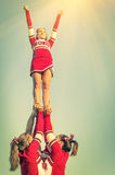 Cheerleaders in action on a vintage filtered look. Concept of unity and team sport - Training at college high school with young female teenagers stock images