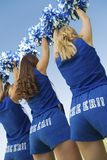 Cheerleaders In Blue Costume Cheering Stock Photography