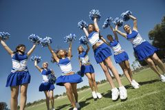 Cheerleaders Cheering On Field Stock Photo