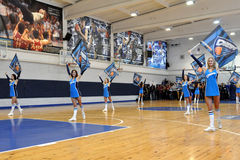 Cheerleaders on the court Stock Images