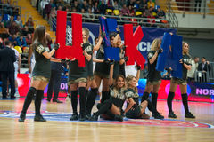 Cheerleaders or CSKA. MOSCOW, RUSSIA - JANUARY 27, 2017: Group of excited young cheerleaders of CSKA team dance on basketball game CSKA vs Anadolu Efes on Stock Photography