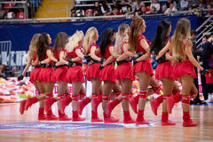 Cheerleaders of CSKA team. MOSCOW, RUSSIA - JANUARY 27, 2017: Cheerleaders of CSKA team  dance on basketball game CSKA vs Anadolu Efes on Regular championship of Stock Images