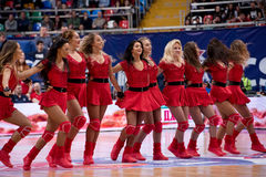 Cheerleaders of CSKA team. MOSCOW, RUSSIA - JANUARY 27, 2017: Cheerleaders of CSKA team  dance on basketball game CSKA vs Anadolu Efes on Regular championship of Stock Photos