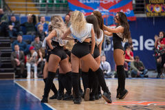 Cheerleaders of CSKA team. MOSCOW, RUSSIA - JANUARY 27, 2017: Cheerleaders of CSKA team  dance on basketball game CSKA vs Anadolu Efes on Regular championship of Royalty Free Stock Images